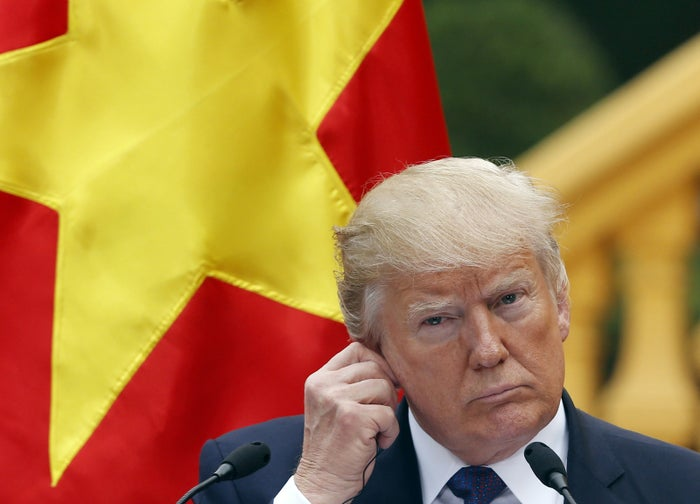 President Trump participates in a press conference at the Presidential Palace in Hanoi, Vietnam, Sunday.