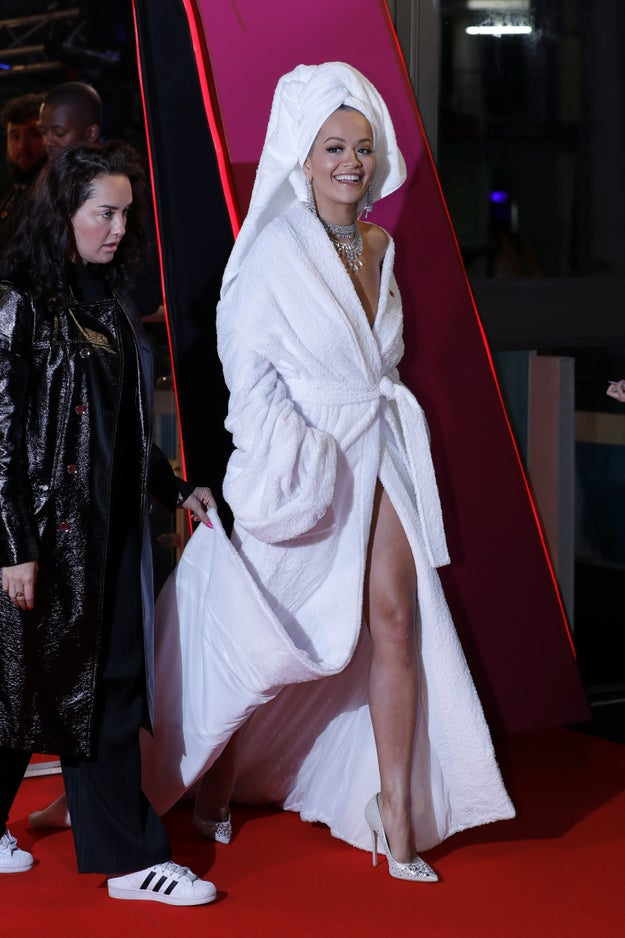 Only Rita could turn up to a red carpet in a floor length bath robe, jewels and towel on her head.