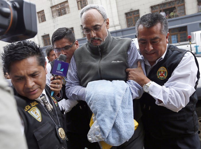 Former president of the Peruvian Football Association Manuel Burga is taken to a courthouse on December 7, 2015.