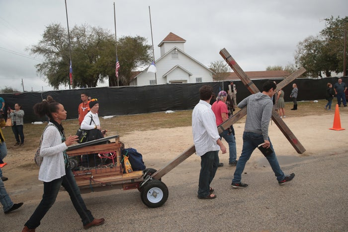 Worshipers pull a cross past the church following Sunday service at the temporary First Baptist Church of Sutherland Springs on November 12.