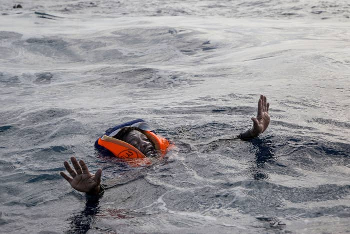 """""""As I took this picture, I could hear how his breath was interrupted by the water flowing into his mouth. I still have the sound of that breath in my head,"""" Paduano told the BBC. """"It was a strong emotional moment but fortunately after a while our rescue raft approached him, now almost drowned, and the crew of Sea-Watch 3, with no small effort, was able to pull him out of the sea."""""""