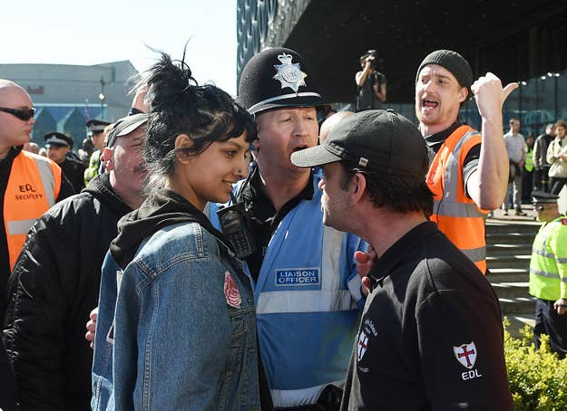 Saffiyah Khan (left) faces down English Defence League protester Ian Crossland during a demonstration in Birmingham in the wake of the Westminster terror attack.