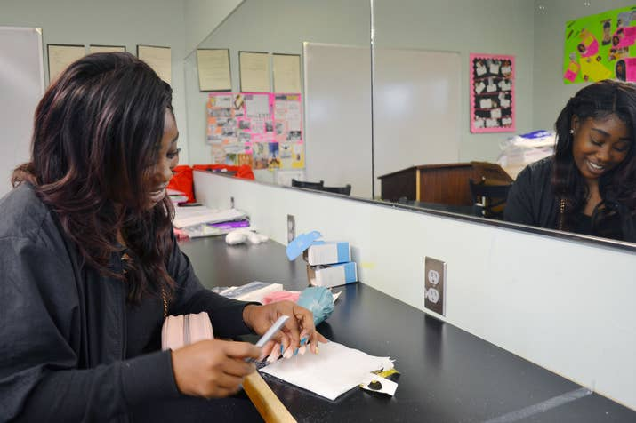 Raven Smith works on a set of acrylic nails during her cosmetology class.