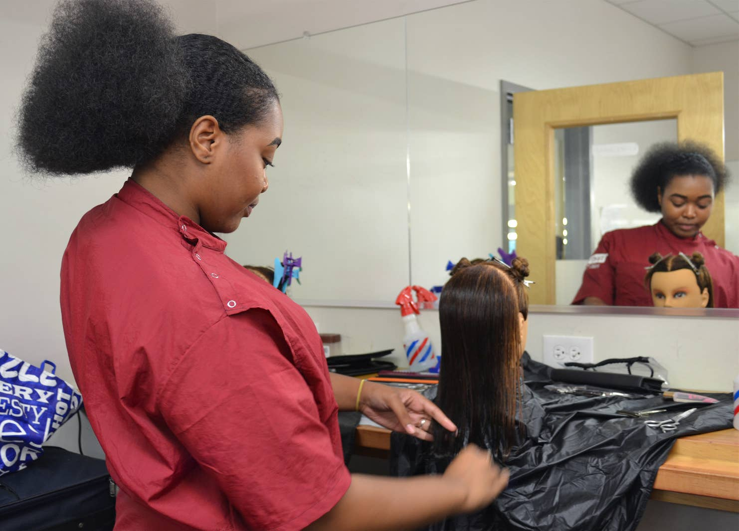 A student practices a haircut in a Pro Way cosmetology class.