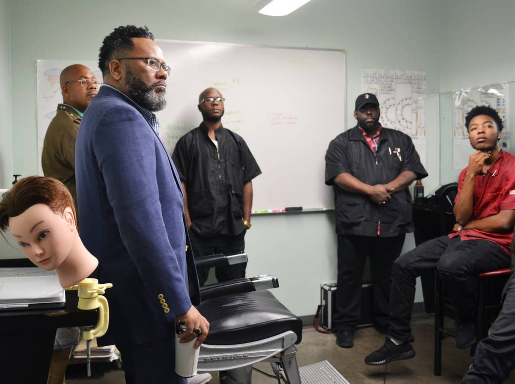 Carl Jordan, Pro Way's director of operations, listens in on a speaker visiting a barbering class.
