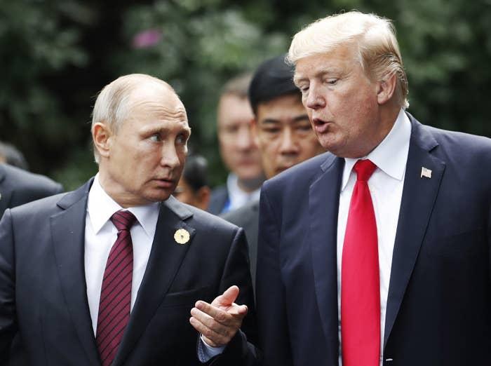 Donald Trump and Vladimir Putin in Vietnam on Saturday.
