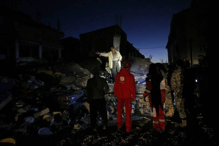 Rescue personnel conduct search and rescue work at Sarpol-e Zahab in Iran's Kermanshah province.