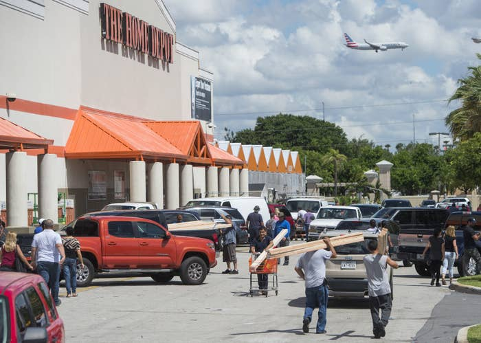 People leave with supplies outside a Home Depot store in Miami, Florida, as they prepare for Hurricane Irma, September 7, 2017.