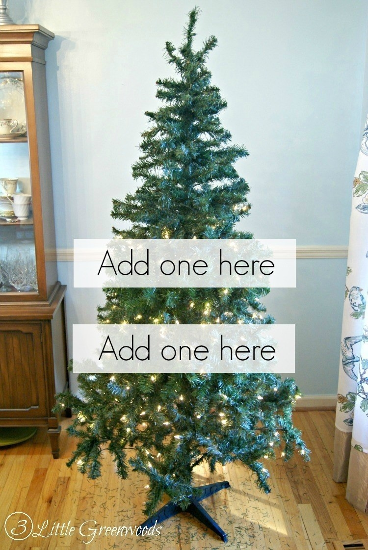 layer dollar wreaths in your artificial tree to add extra fluff - Dollar Store Christmas Tree