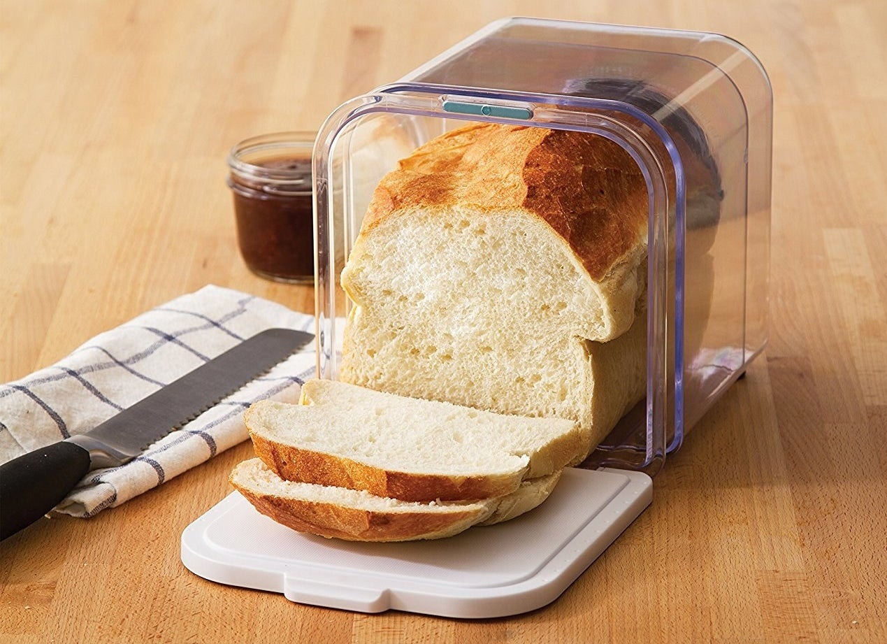 A loaf of bread stored in the clear container