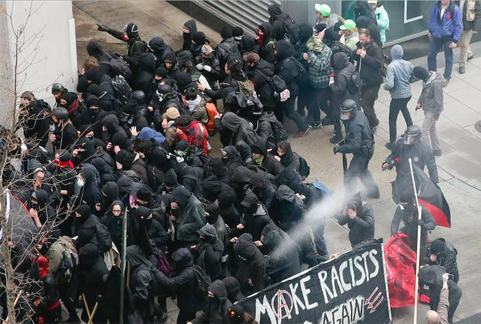 Police use pepper spray on protesters in Washington, DC, on Jan. 20, 2017.