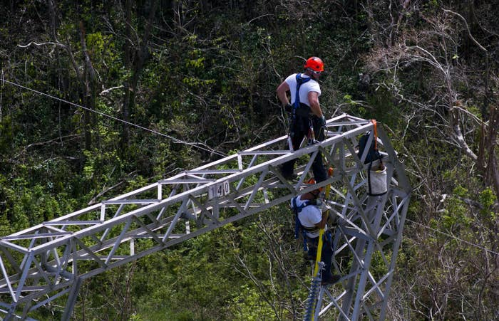 Whitefish Energy workers work on power line towers in Barceloneta, Puerto Rico, Sunday, Oct. 15.
