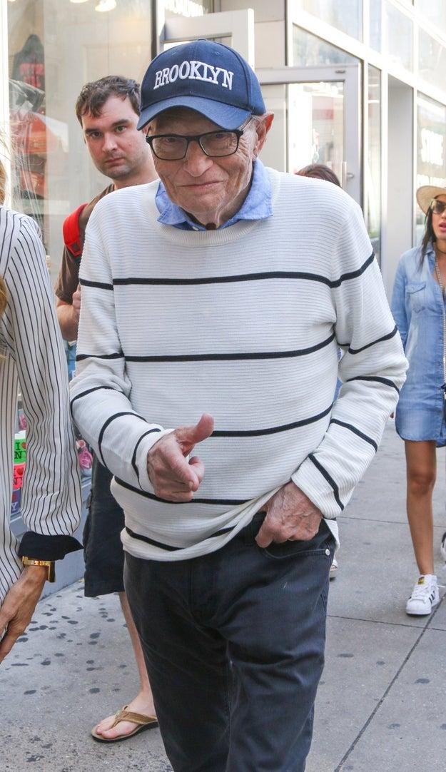 26. Larry King walking down the street