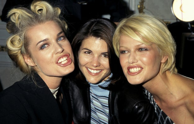 You wanna see backstage? Of course you do. This is what backstage looked like in 1997. Rebecca Romijn, Lori Loughlin (Aunt Becky), and model Ingrid Seynhaeve before the show.