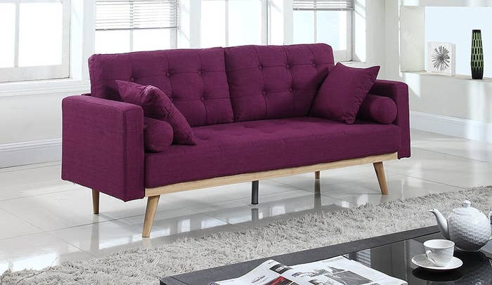"Promising Review: ""Great! It's much longer in person, a real sofa! Pretty color and excellent back support. Bonus points for being really easy to assemble. My cat thinks the arms are the perfect size for sitting. Luckily, it's long enough that I'm allowed to sit on it at the same time as her. Sturdy, beautiful, and inexpensive, does this manufacturer make cars?"" —Spiderbaby FastwolfShipping: Free!Get it from Amazon for $229.99 (available in two colors)."