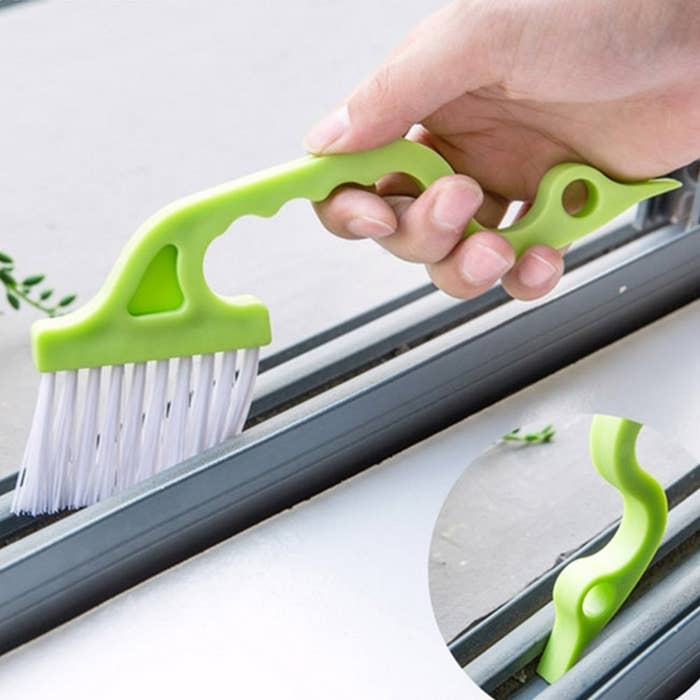"Promising Review: ""This is a great tool for window casings and sliding closet doors, which is exactly what we purchased it for. Bristles are more soft than rigid so it may not be great for heavier duty scrubbing. To clean it I just wipe it off with a damp cloth and let it air dry between uses."" —TTreigerGet it from Amazon for $6.98 or Walmart for $2.99."