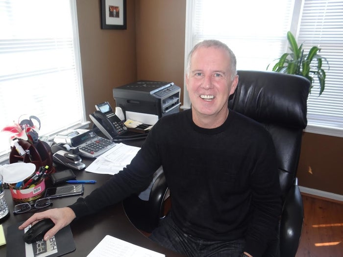 Steve Sullivan, director of Pro Way Hair School, at his desk in Stone Mountain, Georgia.