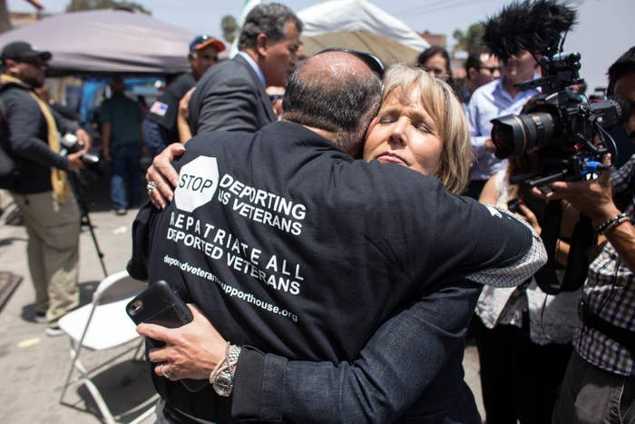 Michelle Lujan Grisham embraces deported veteran Luis Vargas outside the Deported Veterans Support House in Tijuana, Mexico, on June 3, 2017.