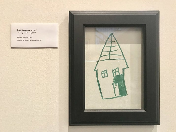 """She decided to stick a frame over the drawing and include a very apt and professional artwork label. """"Interrupted House, 2017"""" is what she titled Ryan's work, with the label: """"Marker on latex paint. Gifted to his parents, by surprise."""""""