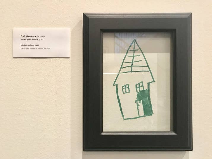 "She decided to stick a frame over the drawing and include a very apt and professional artwork label. ""Interrupted House, 2017"" is what she titled Ryan's work, with the label: ""Marker on latex paint. Gifted to his parents, by surprise."""