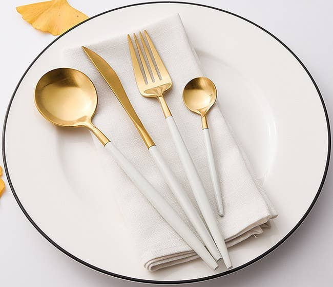 """The four-piece set is lead-, cadmium-, phthalate-, and BPA-free. It includes a dinner knife, dinner spoon, fork, and teaspoon. And it is recommended you hand-wash them. Promising Review: """"This is a very elegant, casual service set. I love mine and will probably order another service for 12. I couldn't be more pleased. It is beautiful and still looks as good as the day I bought it."""" —SisGet the four-piece set from Amazon for $22.99 (available in nine colors)."""