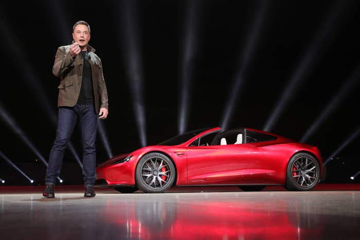 Elon Musk and the new four-seater Tesla Roadster.