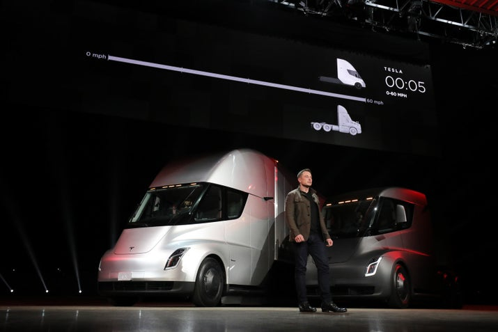 elon musk in front of the new tesla semis at the semi unveil event on thursday