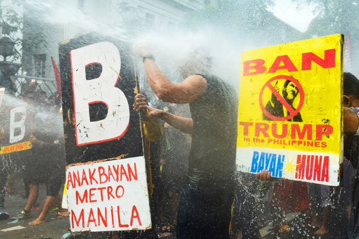 Protesters are dispersed by police blasting them with water cannons as they protest President Donald Trump's arrival at the 31st ASEAN Summit in Manila, Philippines, on Nov. 13.