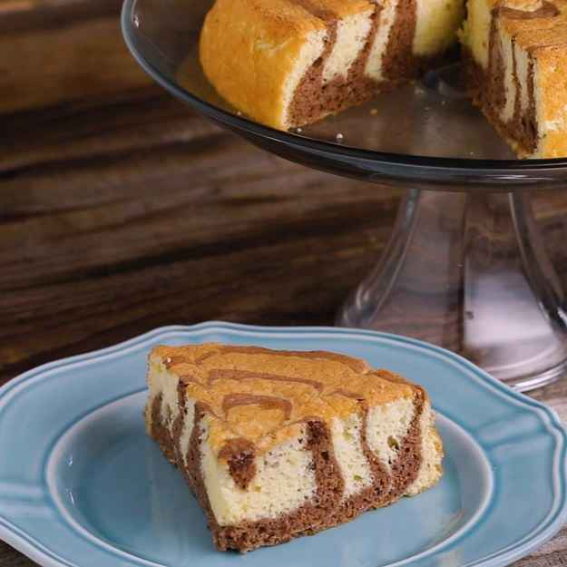 8 servingsINGREDIENTS95 g (3/4 cup) flour1 tablespoon cornstarch1 teaspoon baking powder1/4 teaspoon salt2 tablespoons butter, melted3 tablespoons milk, warm1 teaspoon vanilla extract5  egg, room temperature150 g (3/4 cup) sugar, divided1 tablespoon cocoa powderStrawberry Sauce455 g (1 lb) strawberry, hulled and smashed200 g (1 cup) sugar whipped cream, to servePREPARATION1. Preheat oven to 350˚F (180˚C).2. In a bowl sift the flour cornstarch, baking powder, and salt. Set aside.3. In another bowl, add the butter, milk, and vanilla. Whisk until well-combined. Cover with a kitchen towel and set aside.4. In two large bowls, separate 3 eggs into yolks and whites. Crack the last 2 whole eggs in the bowl with the egg yolks.5. Pour 6 tablespoons of sugar into the egg yolk bowl. Mix on high until the batter is thick and pale yellow, about 5 minutes.6. Beat the egg whites on high until frothy, then gradually add the 6 tablespoons of sugar. Continue beating until soft peaks form.7. Gently fold in the egg yolk mixture into the egg whites.8. Add the flour mixture, continue folding until the flour is mixed in. Create a well in the bowl, pour in the butter mixture. Fold all of the ingredients until the batter is smooth and silky.9. Pour half of the batter into a smaller bowl. Sift the cocoa powder over the batter. Fold in until the cocoa powder is fully incorporated.10. In a greased parchment paper-lined 8-inch (20 cm) cake pan, spoon in a scoop of the vanilla batter in the center of the pan.11. Spoon in a scoop of the chocolate batter over the vanilla in the center.12. Repeat until you have poured about 6 to 8 layers, keeping in mind you will be spooning in a little less batter each layer.13. Using a chopstick or skewer, gently draw a line from the edge of the pan to the center. Repeat until you have made 8 lines. Pour a little chocolate dot in the center.14. Bake for 30 minutes, or until a toothpick comes out clean.15. Use a knife or spatula to gently release the cake from the 