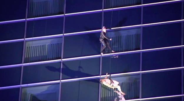 Our queen was seen with some aerial artists rehearsing on the side of a motherflippin' skyscraper in downtown Los Angeles.