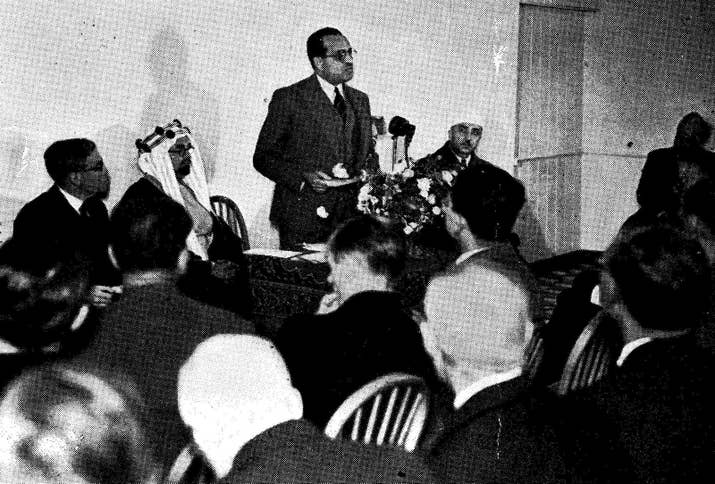 The official opening of the East London Mosque took place on Friday 1 August 1941, for Jumu'a (Friday) prayer. Pictured: Hassan Nachat Pasha (1888-1969), the Egyptian ambassador to the UK (standing); Sheikh Hafiz Wahba, the ambassador of Saudi Arabia (seated left); and Sir Ernest Hotson (seated far left), who had previously been an administrator in India during the British Raj.