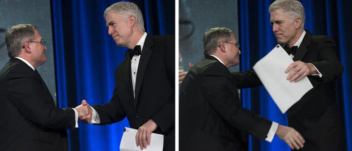 Leonard Leo (left), the executive vice president of the Federalist Society, welcomes Supreme Court Justice Neil Gorsuch on Nov. 16 at the Federalist Society's annual convention.