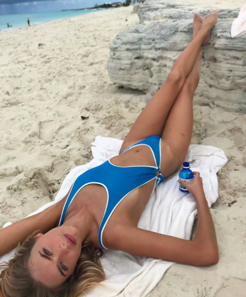 Megan Williams chillin' on the beach with quite possibly no other intentions than to take bomb pics, and we approve this use of time.