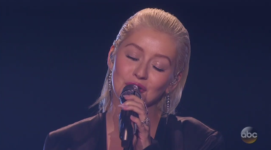 On Sunday at the American Music Awards, Christina Aguilera performed a medley of Whitney Houston's hits to pay tribute to the late singer.