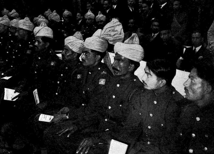 Men of the Indian Contingent and Indian Pioneer Corps sitting with other guests at the opening.