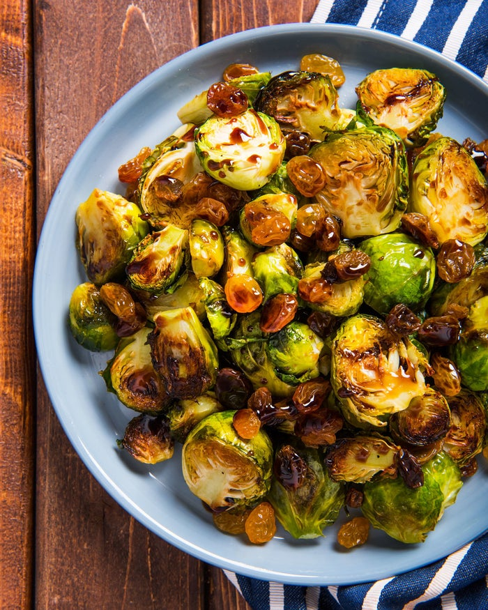 INGREDIENTS3 pounds Brussels sprouts1/2 cup Carlini olive oil1 cup Baker's Corner sugar3/4 cup Carlini balsamic vinegar1 cup Southern Grove golden raisinsPREPARATIONPreheat oven to 375ºF.Cut the stems off the Brussels sprouts, then cut into halves.Coat Brussels sprouts with olive oil and arrange them on a baking sheet. Bake for 20–25 minutes, or until golden brown.While the Brussels sprouts bake, combine sugar and balsamic vinegar in a saucepan. Bring the mixture to a boil, then reduce heat to a simmer. Reduce until the mixture has a syrupy consistency. To serve, mix together the roasted Brussels sprouts and golden raisins before topping with the balsamic drizzle.