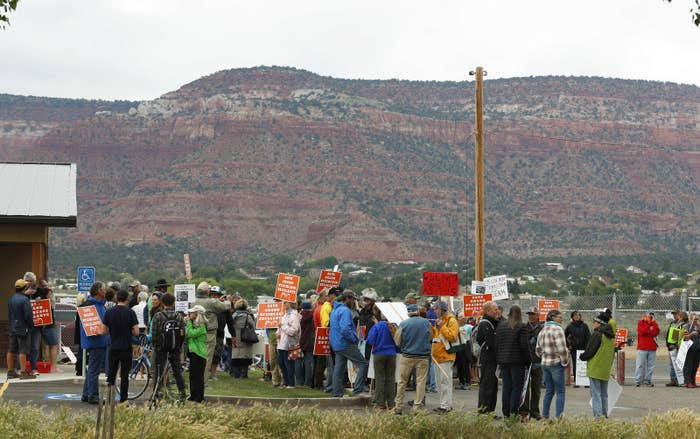 Protesters await Secretary Ryan Zinke in Kanab, Utah, on May 10.