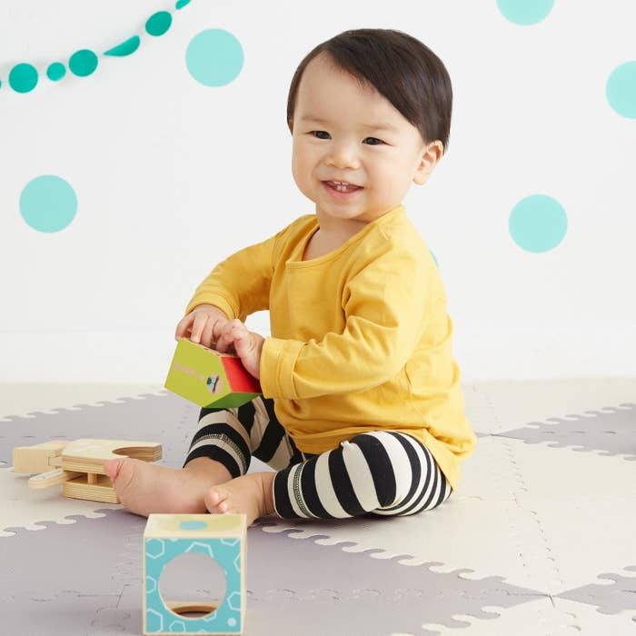 """Includes 40 interlocking triangles and 32 edge pieces. Promising Review: """"We love that this play mat can be configured into different patterns and sizes to fit our needs! It assembles and breaks down with ease but stays put while in use. It cleans easily and provides the protection for our little ones that we were hoping for!"""" —Leenie Get it from Amazon for $78.99."""