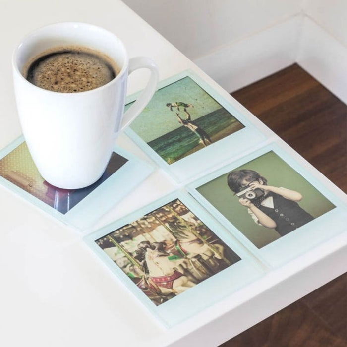 """Print photos that are sized at 8.2 x 8.2cm or 3.3 x 3.3 inches and just slide them in!Promising review: """"Bought this as a gift and they absolutely raved over it, especially since they can change the photos whenever they want."""" —Jasmine T.Price: $12 for a four-pack."""