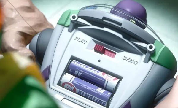 The batteries in Buzz Lightyear's back are made by Buy & Large, the company from Wall-E.