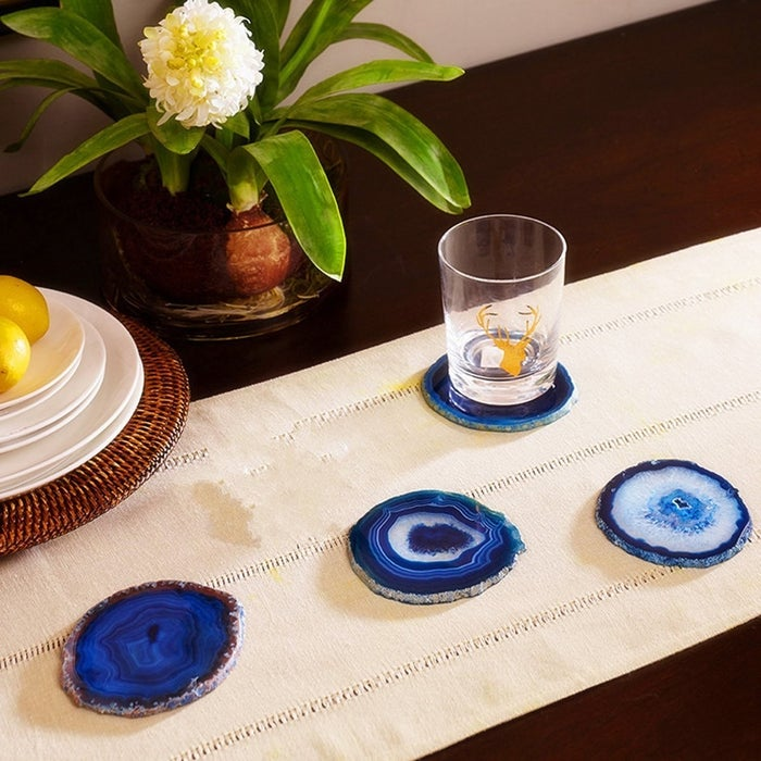 """Promising review: """"I ordered the blue agate coasters for a gift for someone that loves blue as much as me. The coasters were absolutely beautiful and the colors were brilliant and eye catching."""" —Amazon CustomerGet a four-pack from Amazon for $28.99 or Walmart for $25.95."""