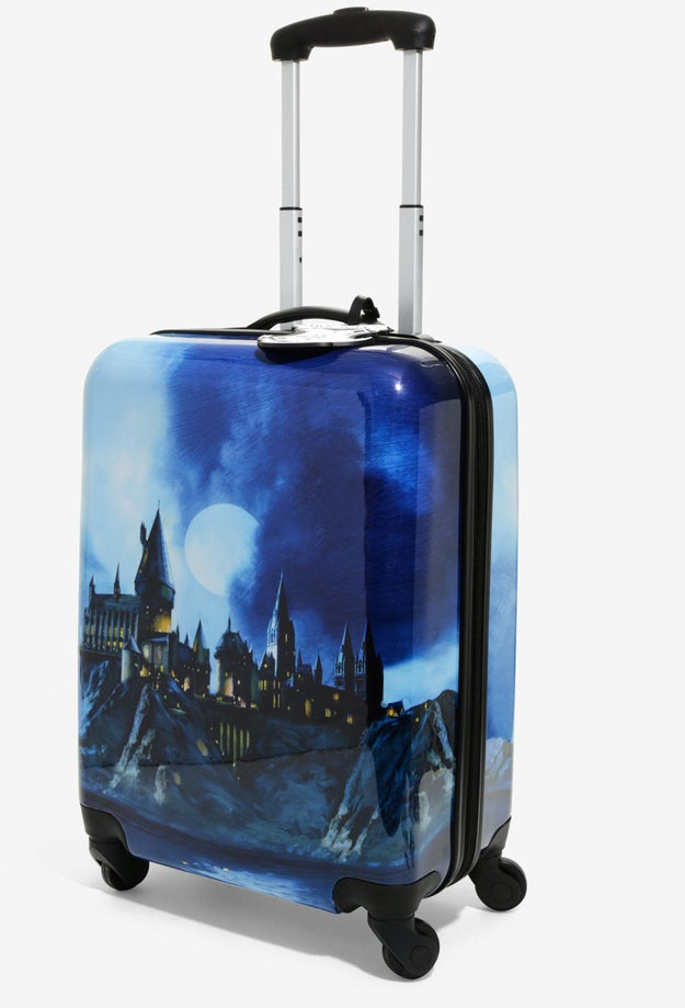 A spinner suitcase depicting the most beautiful architecture known to the wizarding world. I'm tearing up just looking at it.