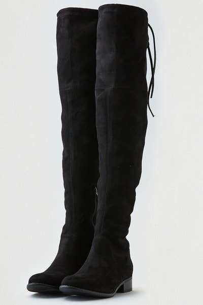 1138e2f2433 A pair of lace-up over-the-knee boots to keep your legs warm in the most  stylish way possible.