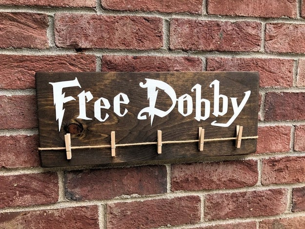 A laundry sign on which you could hang all your mismatched socks. Do you know how many house elves you could free?