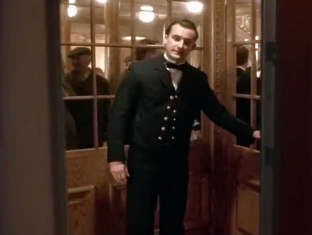 And then this guy holds the door and lets us (ghost Rose) inside a room full of Titanic ghosts.