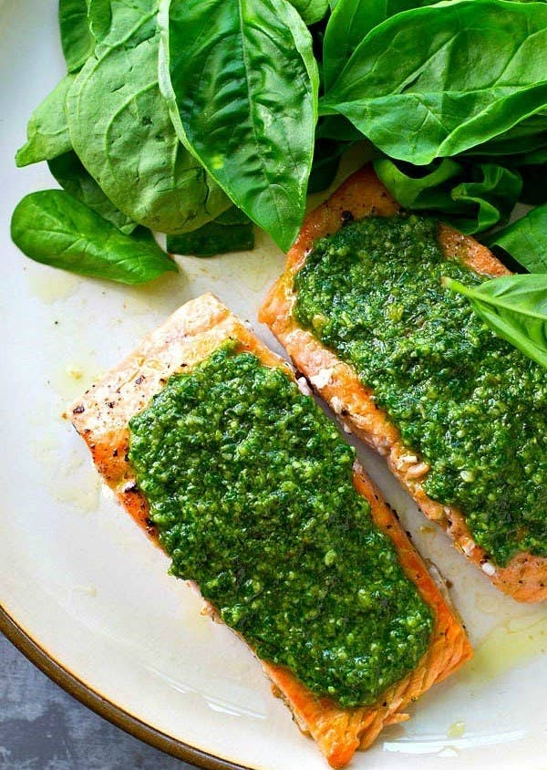 Pan-sear your salmon in a little olive oil, but instead of making pesto from scratch, opt for a store-bought version. You can serve it over spinach or your favorite grains for a little something extra. Get the recipe.
