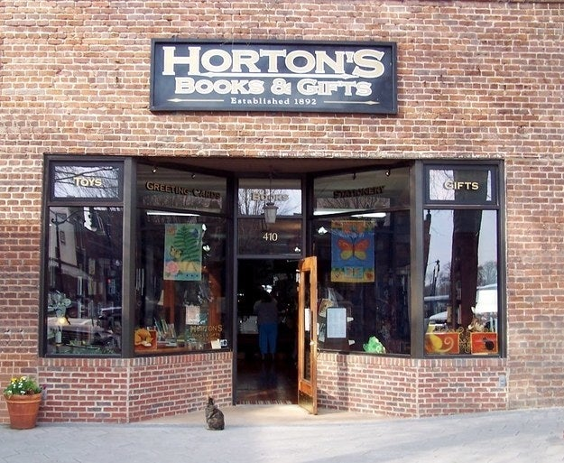 """""""Horton's Books & Gifts is the oldest bookstore in the state of Georgia. It was established in 1892, and they still have the original cash register! The best part is they have three cats: Dante, Mayah (pictured,) and Poe to help guest pick out books."""" —katieb435e59368Visit Horton's Books & Gifts on Sat. 11/25 for free tote bag with purchase of $20, free gift or paperback book with purchase of $40, and 10% off total purchase for Buy a Books for Toys for Tots."""