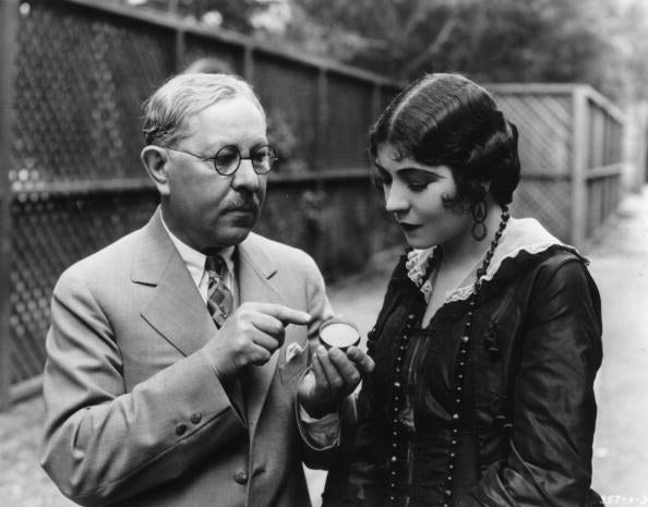Here he is showing off some rouge to actress Renee Adoree, but weirdly not quite looking her in the eye. Good ol' Max.