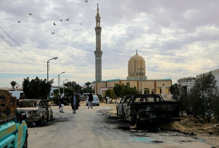 Burned-out vehicles torched by 25–30 militants during the attack are seen outside Al Rawdah mosque in Bir Al-Abed, Egypt.