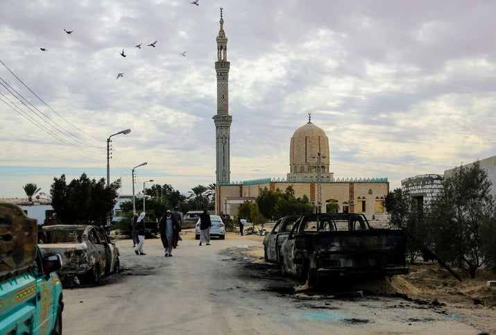 Burned-out vehicles torched by 25-30 militants during the attack are seen outside Al Rawdah mosque in Bir Al-Abed, Egypt.